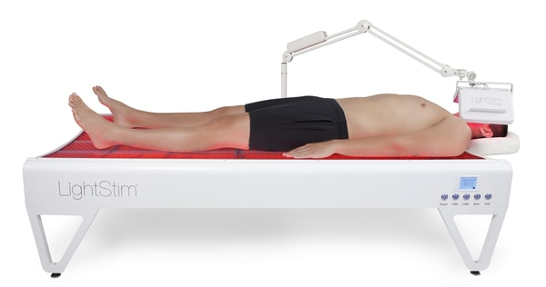 man on the led bed
